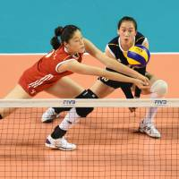 In position: China's Liu Xiaotong stretches to hit the ball against Japan on Friday.  | FIVB