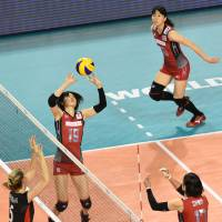 Making it happen: Japan's Haruka Miyashita sets the ball as her team prepares to attack against Belgium on Saturday. | FIVB