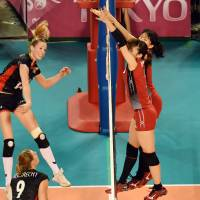 Effort and energy: Belgium's Helene Rosseaux smacks the ball past Japan's frontline on Saturday. | FIVB