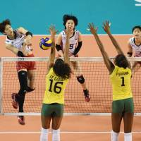 Wing commander: Miyu Nagaoka (left) spikes the ball during Japan's loss to Brazil in the FIVB World Grand Prix Finals at Ariake Colosseum on Sunday. | FIVB