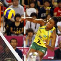 Champion's touch: Brazil's Fabiana Claudino spikes the ball during Brazil's title-clinching win over Japan at the FIVB World Grand Prix Finals on Sunday. | FIVB