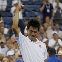 Kei Nishikori reacts after defeating Stan Wawrinka in their U.S. Open quarterfinal match on Wednesday. | REUTERS