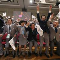 Prime Minister Shinzo Abe of Japan celebrates with members of the Tokyo bid committee as Jacques Rogge President of the International Olympic Committee (IOC) announces Tokyo as the city to host the 2020 Summer Olympic Game during a ceremony in Buenos Aires on Sept. 7, 2013. | REUTERS