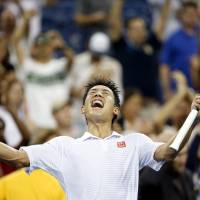 Historic win: Kei Nishikori reacts after defeating Milos Raonic in their fourth-round match at the U.S. Open on Monday.  Nishikori won 4-6, 7-6 (7-4), 6-7 (6-8), 7-5, 6-4 to become the first Japanese man to make the U.S. Open quarterfinals in 92 years. | AP
