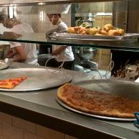 Pizza Slice offers half a dozen variations of New York-style pizza, from simple cheese (¥390) to  homemade meatball pizza (¥650). | ROBBIE SWINNERTON