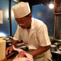 Toriki chef Kunio Aihara breaks down a bird.  | ROBBIE SWINNERTON