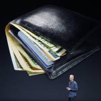 Apple Inc. CEO Tim Cook talks about the Apple Pay e-wallet system during an unveiling event at Flint Center in Cupertino, California, on Tuesday. | REUTERS