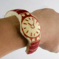This photo supplied on Wednesday by Hiromichi Shoji, who goes by the Twitter handle 'sinomoritsukasa,' shows the 'apple watch' he carved from a real piece of fruit. | HIROMICHI SHOJI/AFP-JIJI