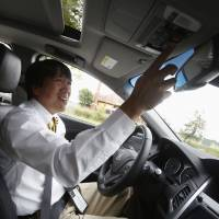 Kei Oshida, Honda R&D Japan's chief engineer, demonstrates the automaker's virtual tow technology at the Intelligent Transport Systems Congress in Detroit on Thursday.   REUTERS