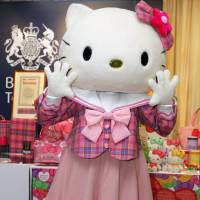 Sanrio Co.'s Hello Kitty poses during a promotional event at the British Embassy in Tokyo in June 2009. Sanrio Co. and publisher Bungeishunju Ltd. will collaborate this fall to celebrate the 40th anniversary of both the popular character and the Bunshun Bunko paperback series. | AP