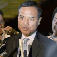 Takeshi Niinami, then-chairman of convenience store chain Lawson Inc., takes reporters' questions at the prime minister's office on June 24, the same day Suntory Holdings Ltd. said it would appoint him president on Oct. 1. | KYODO