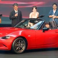 Mazda Motor Corp.'s new Roadster, better known as the MX-5 Miata outside Japan, is unveiled Thursday at an event in Urayasu, Chiba Prefecture. | KYODO
