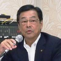 Pioneer Corp. President Susumu Kotani holds a news conference Tuesday afternoon in Tokyo. | KYODO