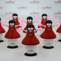 Murata Manufacturing Co.'s cheerleader-themed robots, which balance on balls and synchronize their movements using sensor and communication technologies, are displayed at an event in Tokyo on Thursday. | REUTERS
