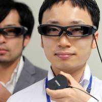 Sony Corp.'s SmartEyeglass is displayed at a news conference at the company's headquarters in Tokyo on Friday. | BLOOMBERG