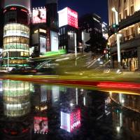 'Abenomics' spurs record wealth, providing solace for rising prices
