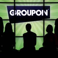Music acts look to Groupon, LivingSocial for help
