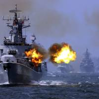 China's Harbin guided missile destroyer takes part in the weeklong China-Russia 'Joint Sea-2014' naval exercise in the East China Sea in May. | AP