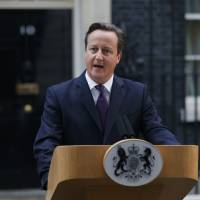 Britain's Prime Minister David Cameron speaks to the media Friday in front of Number 10 Downing Street in London regarding the results of the Scottish independence referendum.   REUTERS