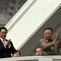 North Korean leader Kim Jong Il (right) applauds with Zhou Yongkang, then a member of China's Political Bureau and the Secretariat of the Communist Party of China's Central Committee, after a parade to commemorate the 65th anniversary of founding of the Workers' Party of Korea in Pyongyang on Oct. 10, 2010.   REUTERS