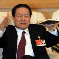 Former Chinese Politburo Standing Committee member Zhou Yongkang speaks at a discussion meeting during the National People's Congress at the Great Hall of the People in Beijing in March 2011.   REUTERS