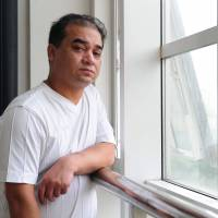 Professor Ilham Tohti poses before a classroom lecture in Beijing on June 12, 2010. | AFP-JIJI