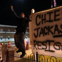 Ferguson unrest persists despite police chief's conciliatory gesture