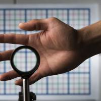 A cloaking device using four lenses developed by University of Rochester physics professor John Howell and graduate student Joseph Choi is demonstrated in Rochester, New York, on Sept. 11. | REUTERS