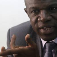 Dr. Daouda Coulibaly, head of epidemiological monitoring service of the National Institute for Public Health of Côte d'Ivoire (INHP) in charge of Ebola, speaks during an interview in Abidjan last week. The country is taking the kind of aggressive anti-infection measures that its poorer, smaller western neighbors were slow to adopt. Hand-washing stations have appeared at the entrances of government buildings and office towers in Abidjan, the bustling economic capital. People have abandoned the traditional three-kiss greeting. | REUTERS