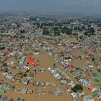 Kashmiri houseboats and houses submerged by floodwaters are seen from an Indian air force helicopter during rescue and relief operations in Dal Lake in Srinagar on Wednesday. | AFP-JIJI