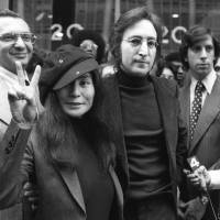 John Lennon and Yoko Ono leave a U.S. Immigration hearing in New York City on April 18, 1972. | AP