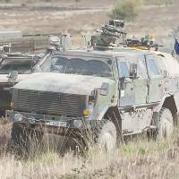A German armored infantry vehicle takes part in combat training in Letzlingen, eastern Germany, in August 2009. Chancellor Angela Merkel told German lawmakers on Monday that arming Kurdish fighters in Iraq is in their country's interest. | AP