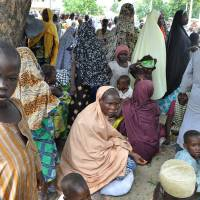 Civilians who fled their homes following an attack by Islamist militants in Bama, Nigeria, take refuge at a School in Maiduguri on Wednesday. A Nigerian senator says thousands of people are fleeing the northeastern city of Bama amid conflicting reports that it has been seized by Boko Haram Islamic militants. Sen. Ali Ndume said Tuesday the military is claiming it has repelled the insurgents in fierce fighting for the city, but the stream of refugees indicates otherwise. | AP