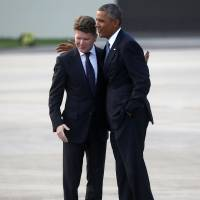 President Barack Obama is greeted by U.S. Ambassador to Great Britain Matthew Barzun as he arrives on Air Force One at Royal Air Force Station Fairford, Wednesday, to attend the NATO Summit in Wales. | AP