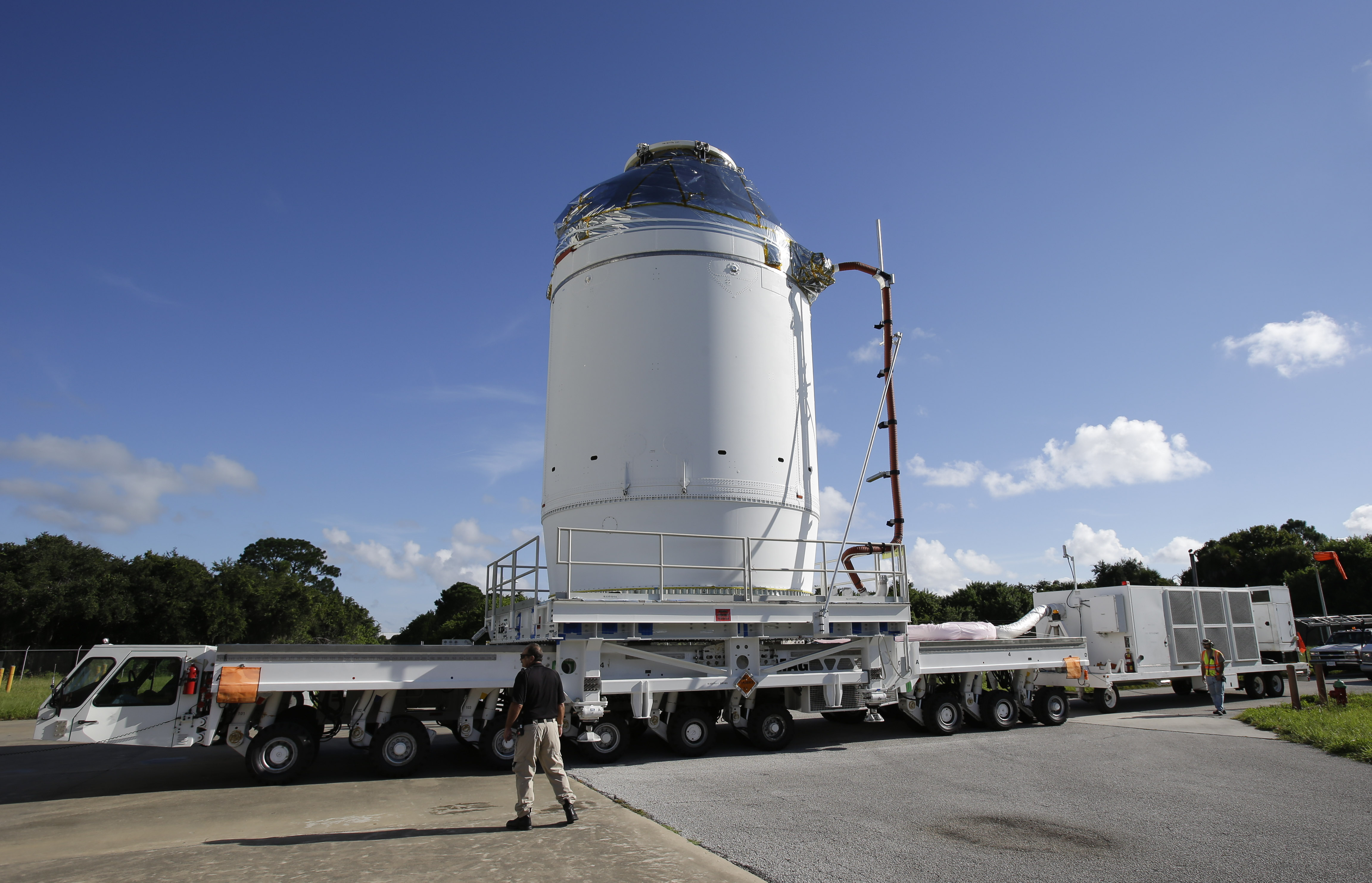 NASA's Orion spacecraft, preparing for its first flight, moves toward the Payload Hazardous Servicing Facility at the Kennedy Space Center on Thursday at Cape Canaveral, Florida. Orion is scheduled for a test flight in early December.   AP