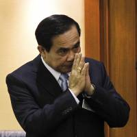 Thailand's then-army chief, Gen. Prayuth Chan-ocha, gestures in a traditional greeting during the start of a National Legislative Assembly meeting in Bangkok on Aug. 18.   REUTERS