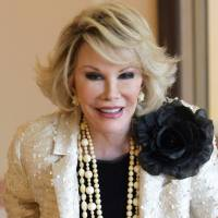 Joan Rivers poses in 2009 as she presents 'Comedy Roast with Joan Rivers ' during the 25th MIPCOM (International Film and Programme Market for TV, Video, Cable and Satellite) in Cannes, southeastern France. Rivers, the raucous, acid-tongued comedian who crashed the male-dominated realm of late-night talk shows and turned Hollywood red carpets into danger zones for badly dressed celebrities,  died Thursday. She was 81. | AP