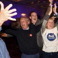 Supporters from the 'No' Campaign react Friday morning to a declaration in their favor, at the Better Together Campaign headquarters in Glasgow, Scotland. | REUTERS