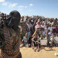 In this Feb. 13, 2012, file photo, an armed member of the militant group al-Shabab attends a rally in support of the merger of the Somali militant group al-Shabab with al-Qaida, on the outskirts of Mogadishu. U.S. military forces targeted the Islamic extremist al-Shabab network in an operation Monday in Somalia, the Pentagon said. | AP