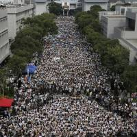 Students stage a rally at the Chinese University of Hong Kong campus in Hong Kong on Monday. | AP