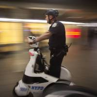 A policeman on a scooter patrols the Times Square subway station in Manhattan, New York, on Thursday after Iraqi Prime Minister Haider al-Abadi  said he has 'credible' intelligence that Islamic State militants plan to attack subway systems in the United States and Paris. | REUTERS