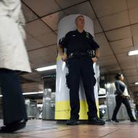 A policeman keeps vigil at a subway station in New York on Thursday. Iraq's prime minister, Haider al-Abadi, who is attending the 69th session of the United Nations General Assembly in New York, said his country's intelligence operation has uncovered a plot for an attack on subway systems in the United States and Paris. | AFP-JIJI