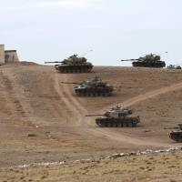 Turkey deploys tanks to Syria border as lawmakers weigh action against Islamic State group