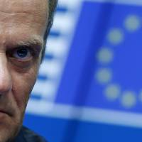Newly elected European Council President Donald Tusk attends a news conference during an EU summit in Brussels on Saturday. | REUTERS