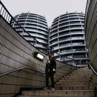 A man walks down a flight of stairs near buildings surrounding 'Silicon Roundabout' in London in May last year.   REUTERS