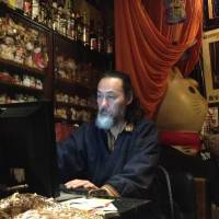Smooth networking: Jiken Miyazaki updates the website of his jazz cafe Samurai. Cafe owners are increasingly trying new ways to attract younger customers. | JAMES CATCHPOLE