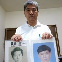 Takashi Fujita holds a photo of his brother Susumu, who went missing in 1976 (left), and a photo of a Japanese man who is believed to be Susumu after he was allegedly abducted to North Korea, during a recent interview at his home in Kawaguchi, Saitama Prefecture. | REIJI YOSHIDA