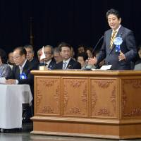 Prime Minister Shinzo Abe delivers a speech at a conference on North Korea's abduction of Japanese citizens at Hibiya Public Hall in Chiyoda Ward, Tokyo, on Saturday.   KYODO