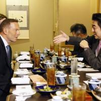 Prime Minister Shinzo Abe and his Australian counterpart, Tony Abbott, met for lunch in New York on Wednesday. | KYODO