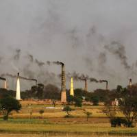 Smoke billows from brick kilns on the outskirts of New Delhi. More than 100 world leaders met Tuesday at the U.N. Climate Summit in New York to discuss measures to curb emissions. | AP
